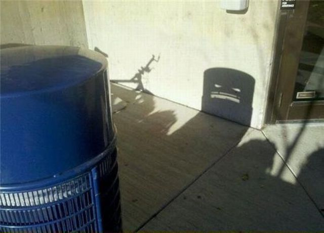 Shadow of a bin that looks like a monster