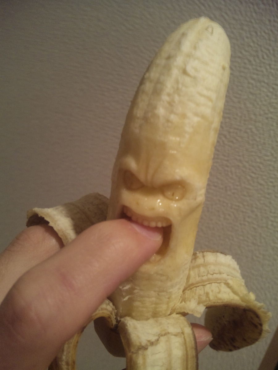 Angry face carved into a banana