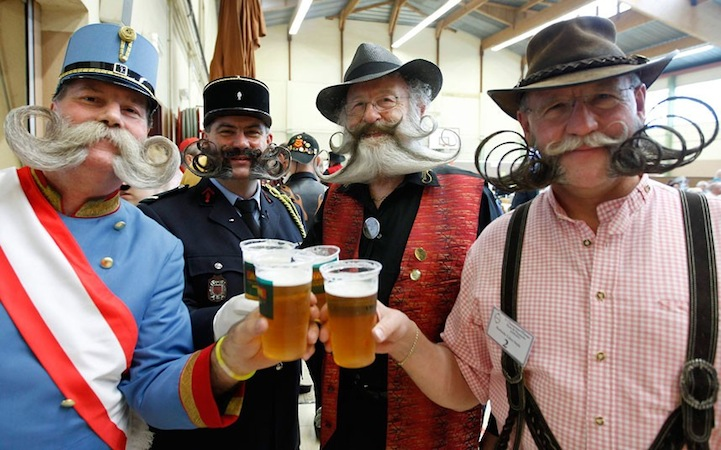Moustache Championship entrants drinking