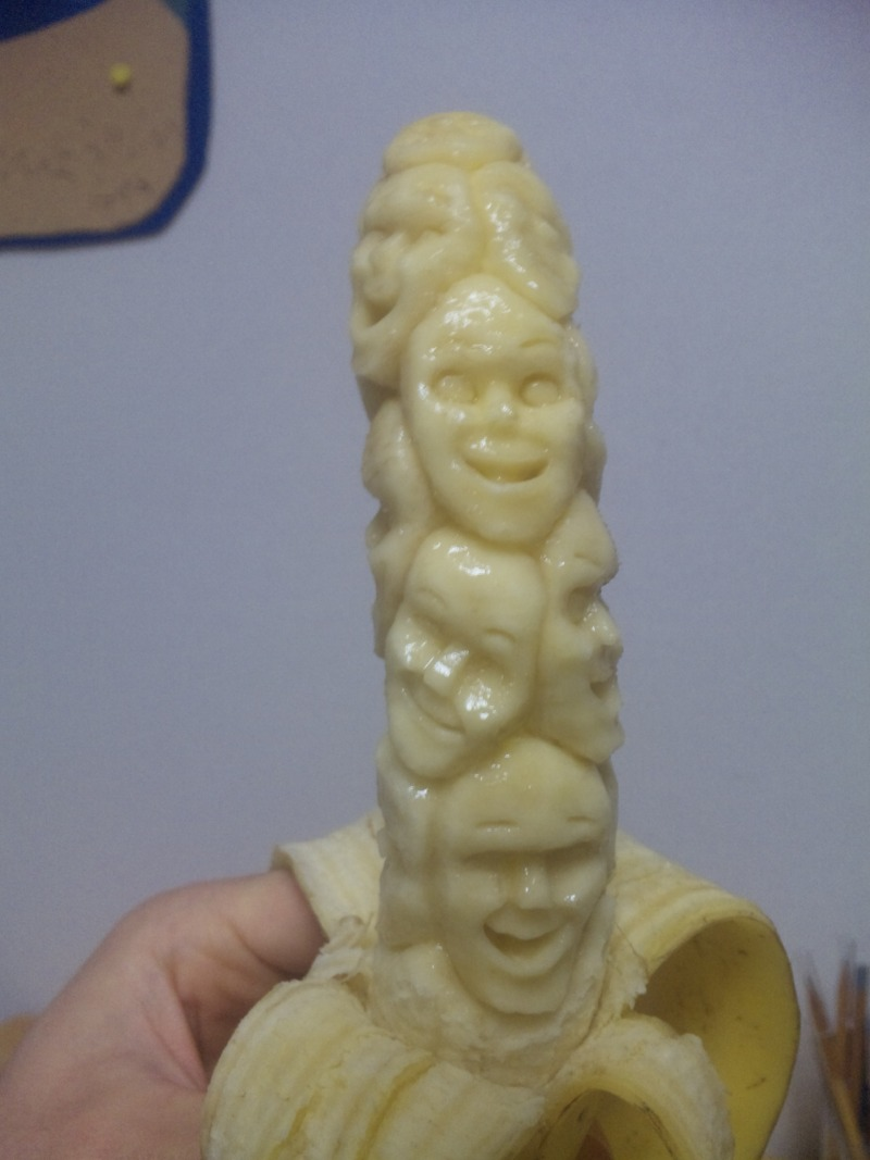 Faces carved out of a banana