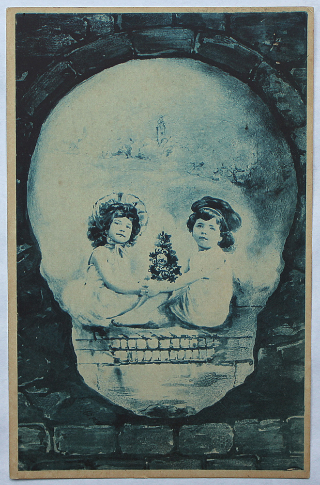 An ambiguous image of two young girls sitting and a skull