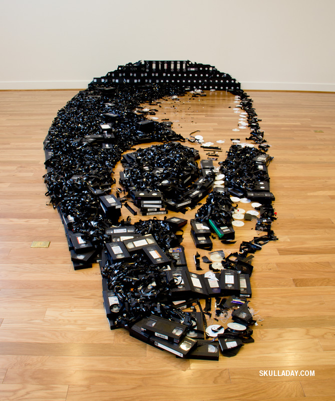 Sculpture of a skull made from VHS tapes