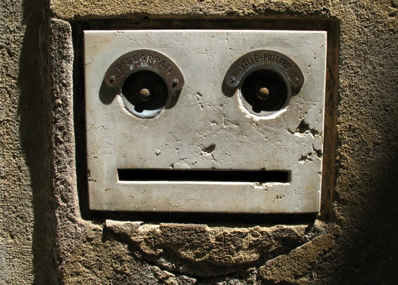 Some kind of concrete box in a wall with a face
