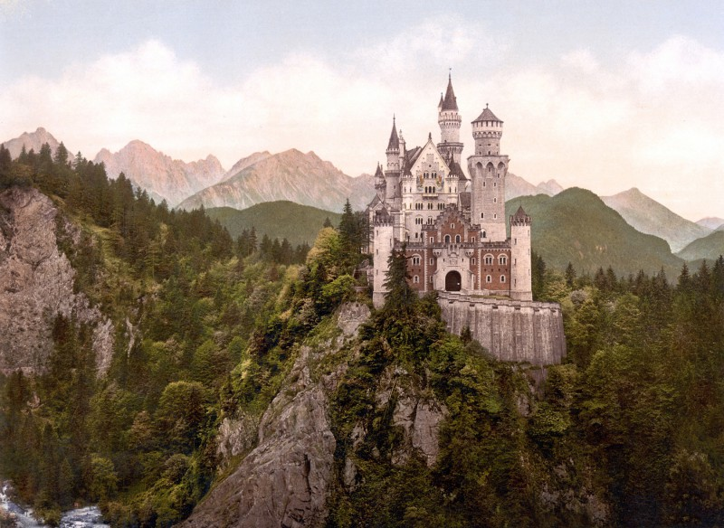 Neuschwanstein Castle atop rocky cliffs