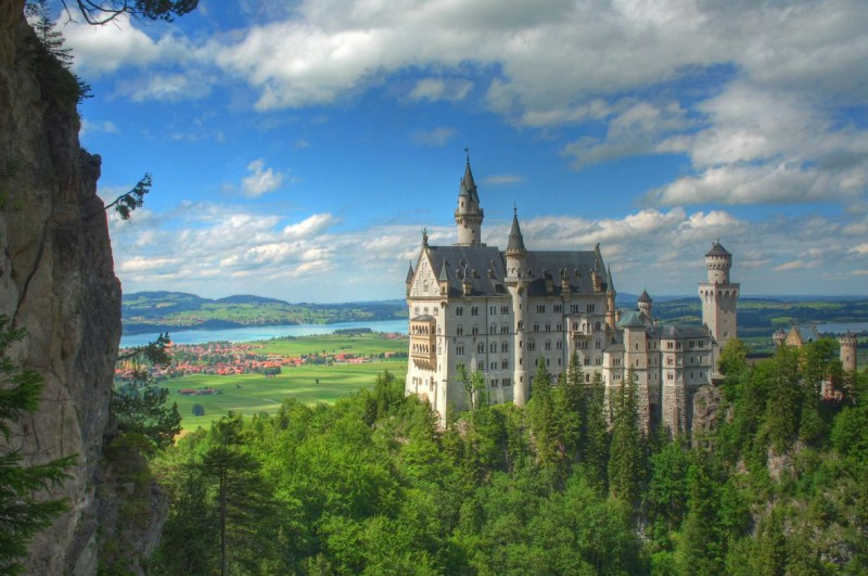 Neuschwanstein castle surrounded by green trees