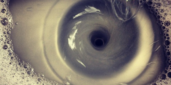 Photograph of a draining sink that looks like an eye