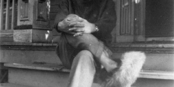 Einstein sitting on steps wearing fuzzy slippers