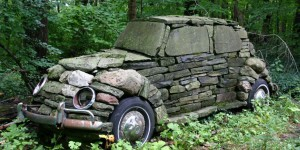 Old car covered in rocks