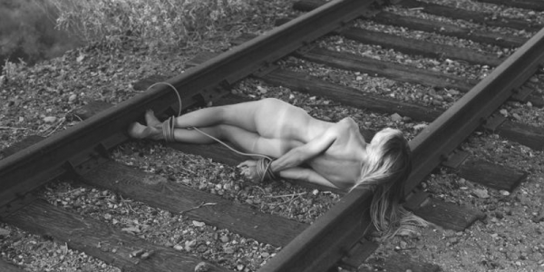 Nude girl tied to train tracks