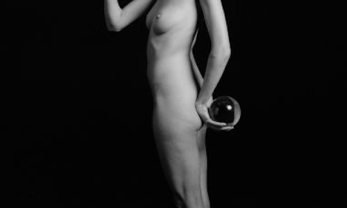 Nude girl holding an owl and an orb
