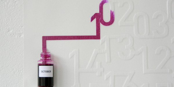 Ink calendar marking days with seeping ink