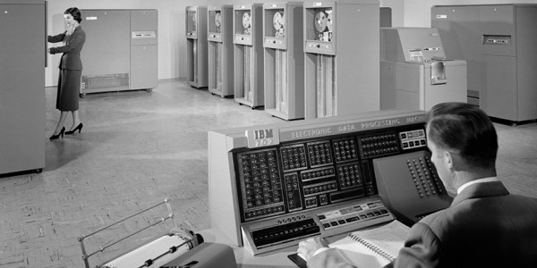 Black and white photo of a computer room in 1955
